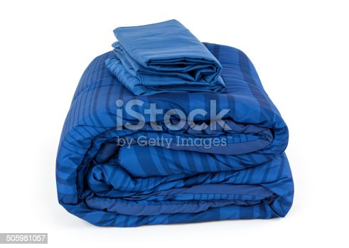 Blue comforter blanket and sheet set, isolated on white.