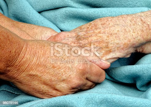 Comforting Hands Stock Photo & More Pictures of 50-59 Years