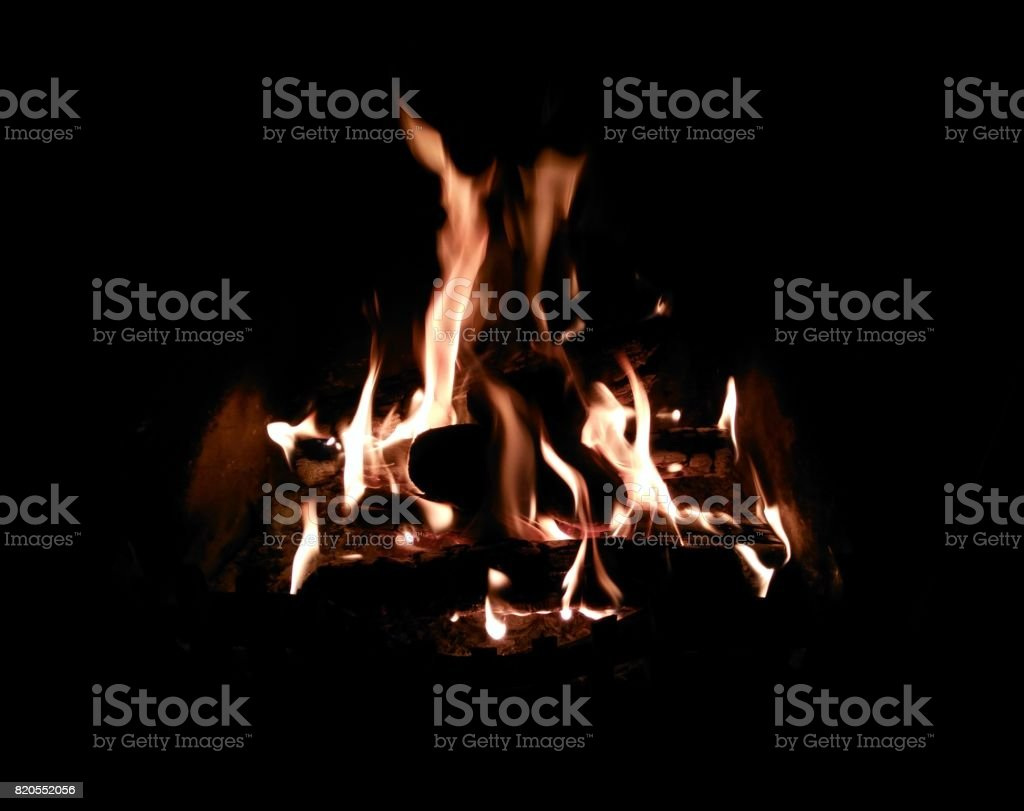 Comforting Home Fire - Flames Silhouetted stock photo