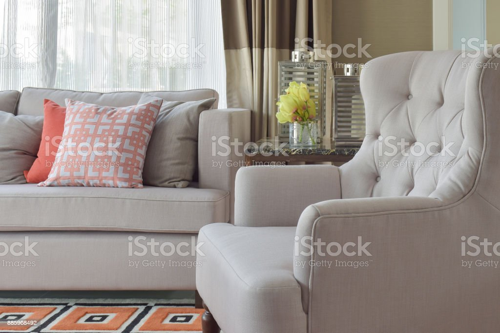 Comfy beige arm char with chinese style in orange theme living corner stock photo