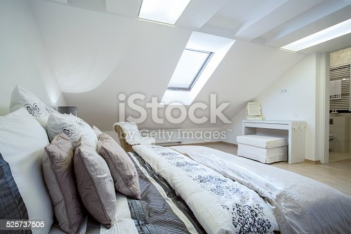 istock Comfy enormous bed in bright bedroom 525737505
