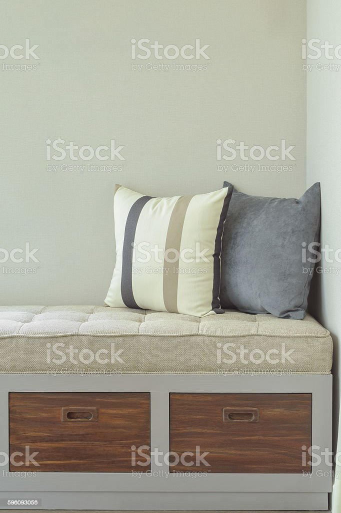 Comfy seat with storage next to window royalty-free stock photo