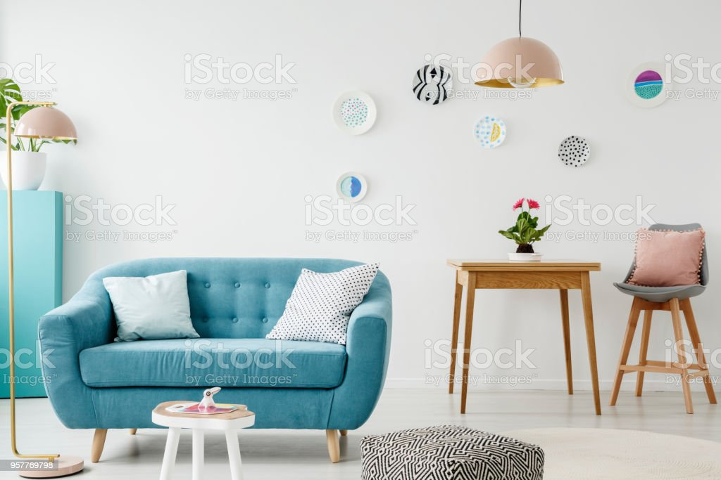 Comfy Sofa Coffee Table Pouf Wooden Table And Chair And Hanging Patterned Plates In A Sweet Living Room Interior Stock Photo Download Image Now Istock