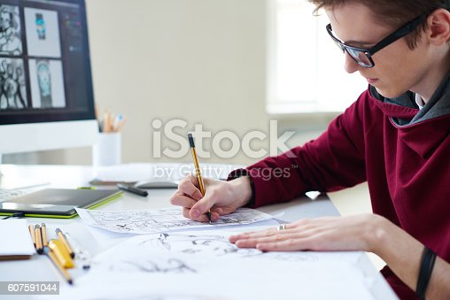 istock Comic artist at work 607591044