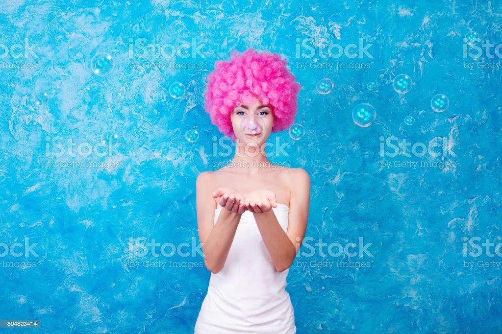 Comic girl / woman / teenager with pink wig stock photo