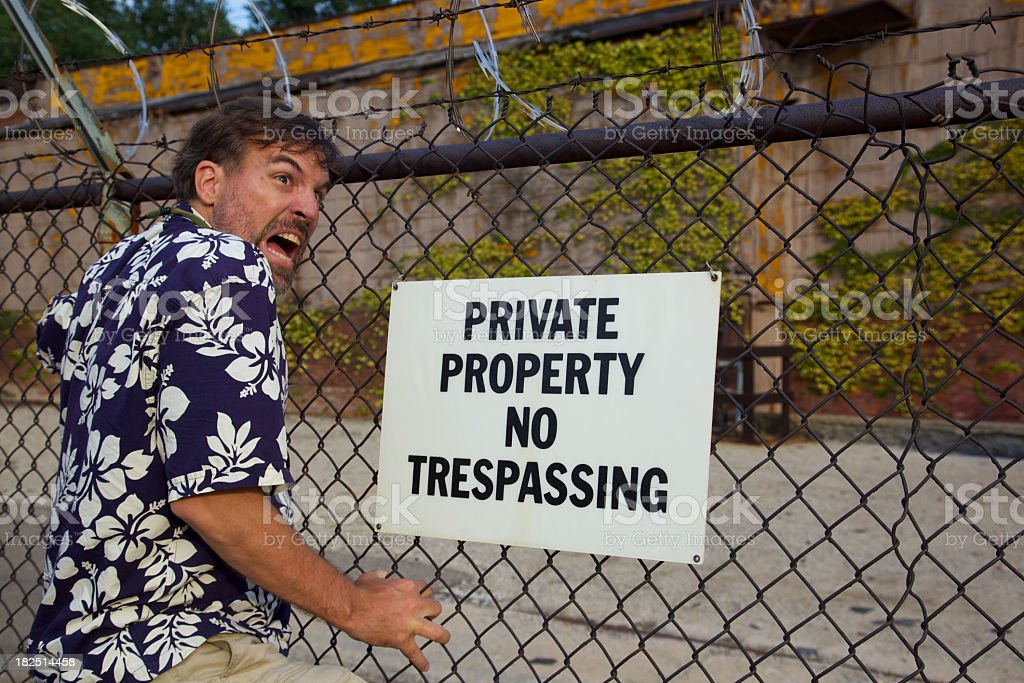Comical No Trespassing Arrest royalty-free stock photo