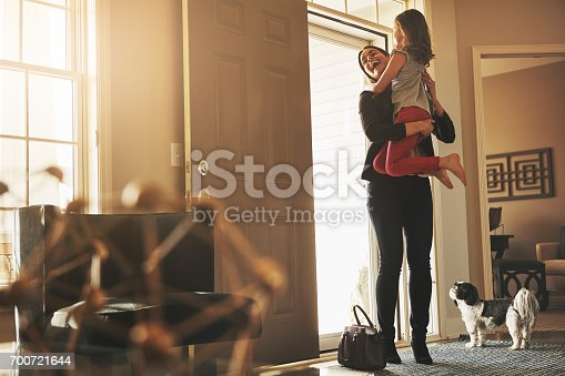 Shot of a happy mother arriving home to a loving welcome from her daughter