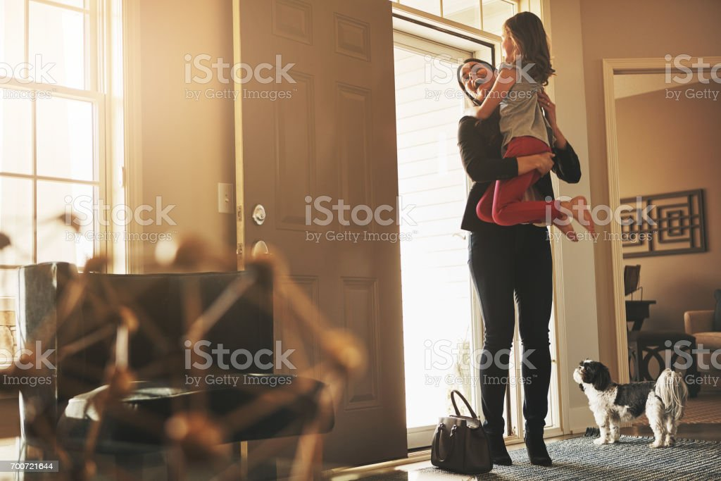 Coming home to her loving arms is worth it stock photo