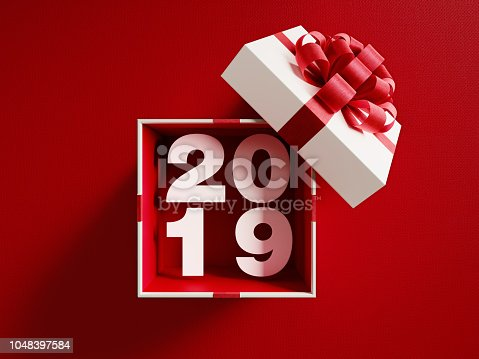 istock 2019  Coming Out Of A White Gift Box Tied With Red Ribbon 1048397584