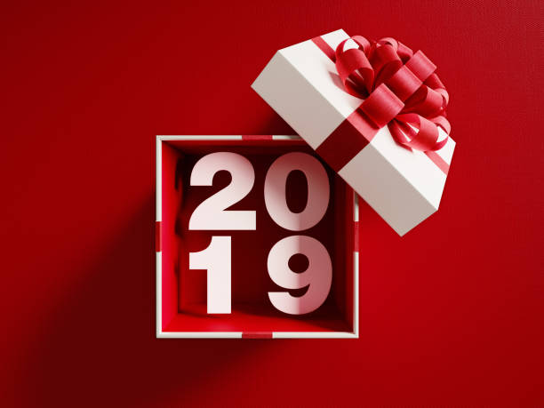 2019  Coming Out Of A White Gift Box Tied With Red Ribbon stock photo