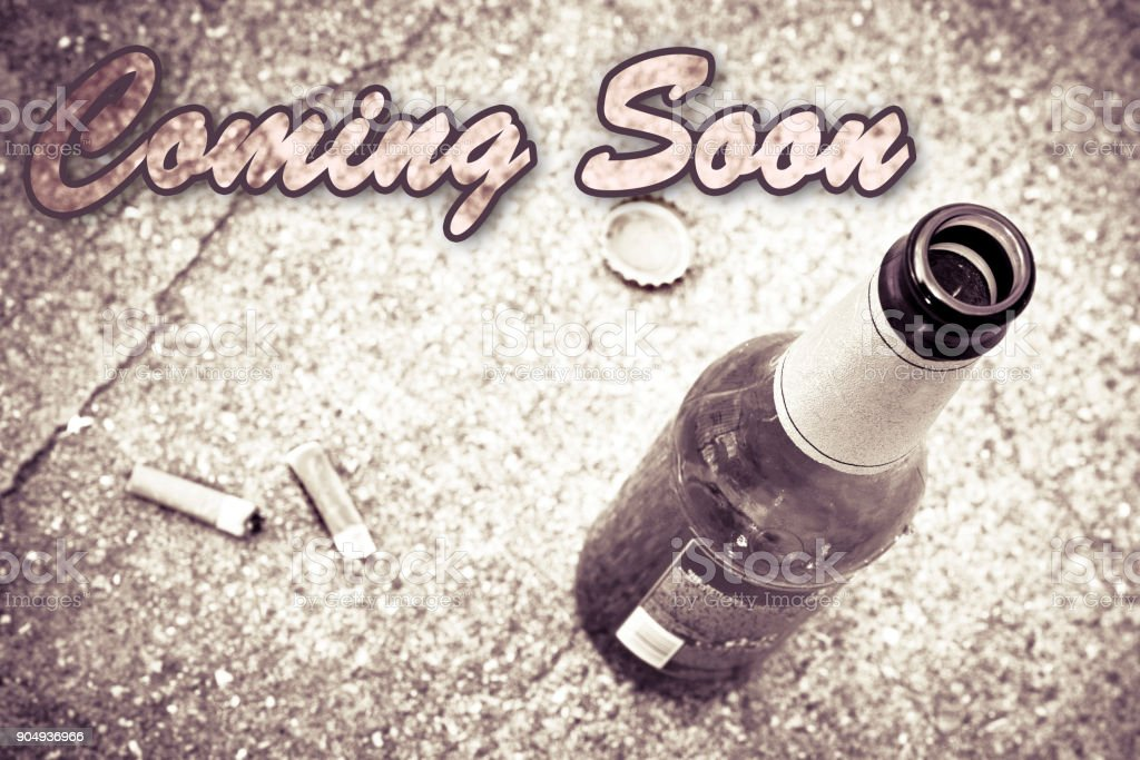 Coming soon concept with bottle of beer - concept image stock photo