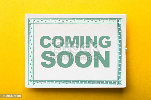 843847560 istock photo Coming Soon Label On Yellow Background 1258078258