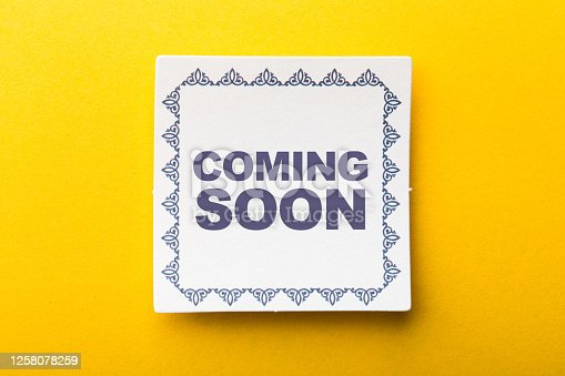 843847560 istock photo Coming Soon Label On Yellow Background 1258078259