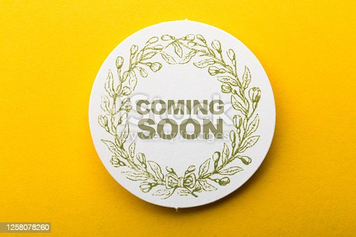 843847560 istock photo Coming Soon Label On Yellow Background 1258078260