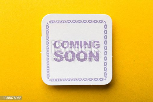 843847560 istock photo Coming Soon Label On Yellow Background 1258078262