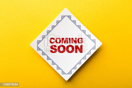 843847560 istock photo Coming Soon Label On Yellow Background 1258078264