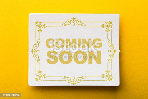 843847560 istock photo Coming Soon Label On Yellow Background 1258078266