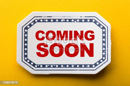 843847560 istock photo Coming Soon Label On Yellow Background 1258078275