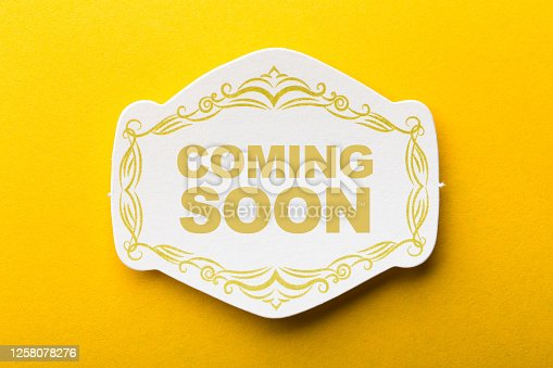 843847560 istock photo Coming Soon Label On Yellow Background 1258078276