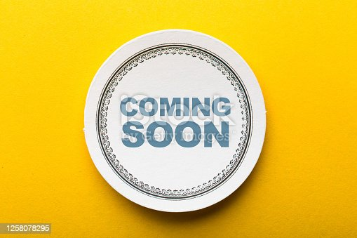 843847560 istock photo Coming Soon Label On Yellow Background 1258078295