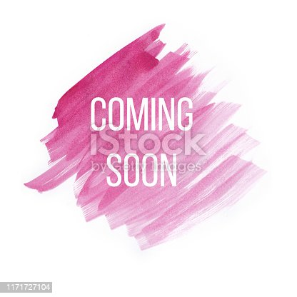 istock Coming soon on pink watercolor brush strokes on white background 1171727104