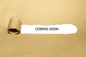 istock Coming Soon Ripped Paper Concept 1199076890