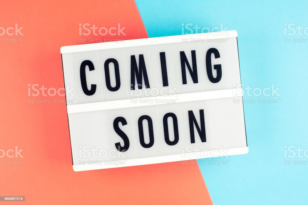 Coming Soon Text On A Display Lightbox On Blue And Red