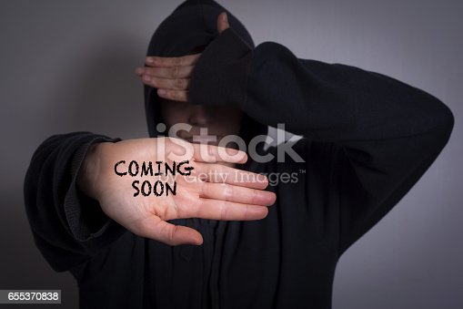 843847560 istock photo Coming Soon. Women showing hand with text 655370838