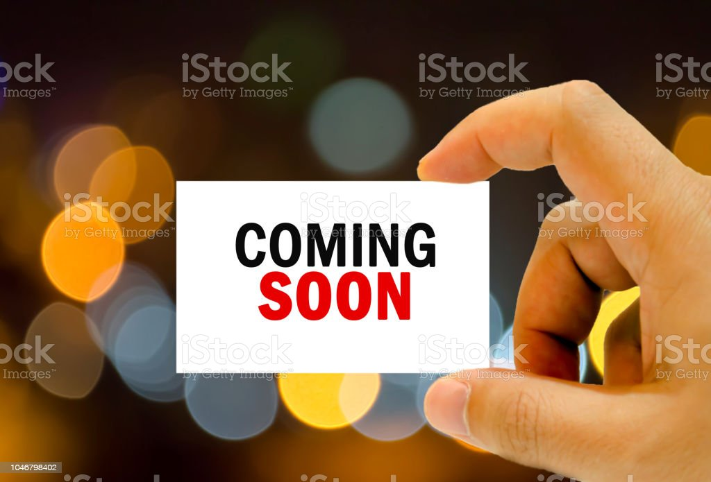 coming soon written on business card stock photo