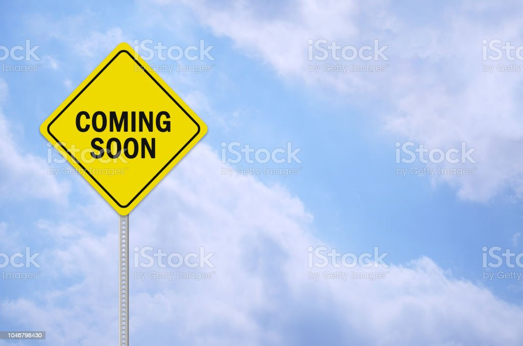 coming soon written on traffic sign stock photo