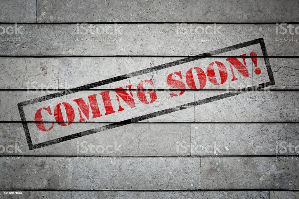 Coming Soon Written on Wall Background stock photo