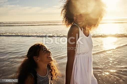 Shot of a mother and her little daughter bonding together at the beach