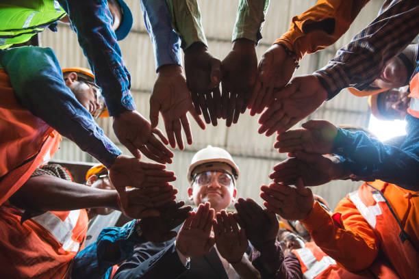 Coming together in a circle for unity stock photo