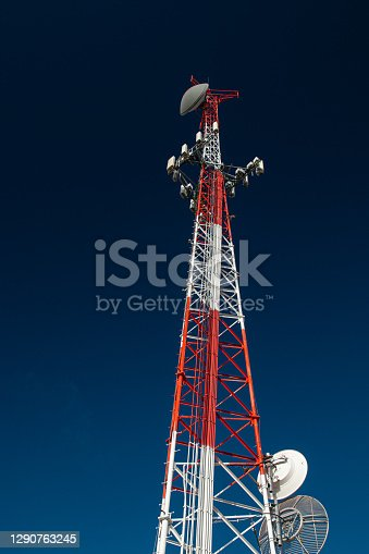 A red and white communications tower.