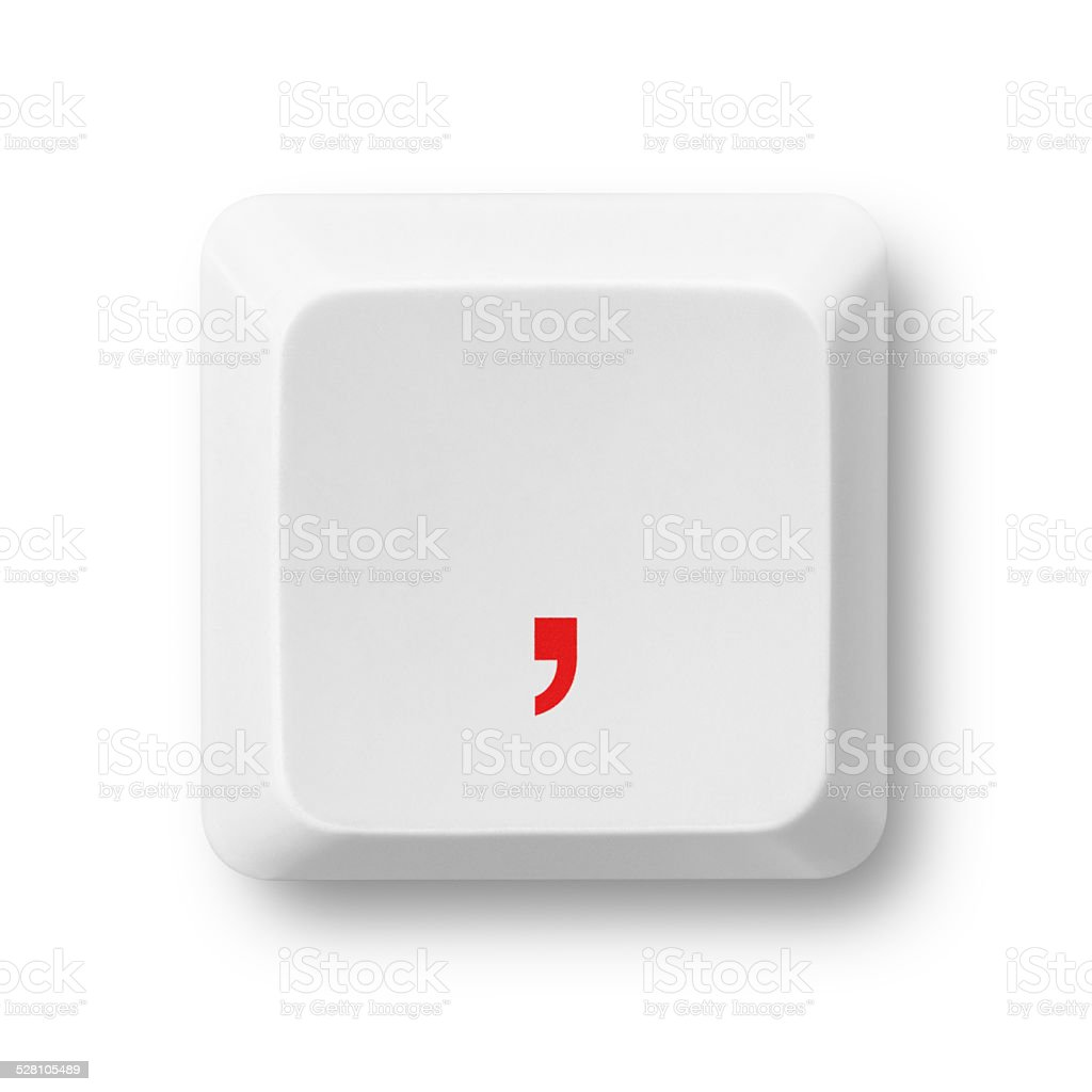 Comma symbol on a computer key isolated on white stock photo