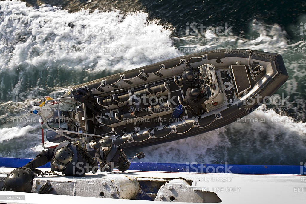 Commandos Board the Ship from a Rigid-Hulled Inflatable Boat stock photo