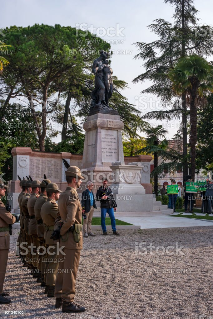 Commemoration ceremony at the monument to the fallen soldiers. Veterans and military are taking part in the event memory. stock photo
