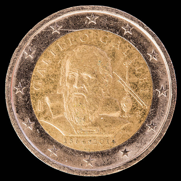 Commemorative two euro coin issued by Italy in 2014 A commemorative circulated two euro coin issued by Italy in 2014 to celebrate the Italian astronomer, physicist, engineer and mathematician Galileo Galilei. Image isolated on black background. galileo galilei stock pictures, royalty-free photos & images