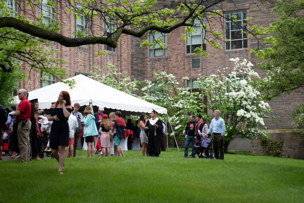 Commencement day at Cornell University Ithaca, USA - May 27, 2018. Students and their family members in the campus of Cornell University on commencement day. Cornell University is a top rank ivy league University in US, located in the city of Ithaca in finger lakes region of New York State. ivy league university stock pictures, royalty-free photos & images