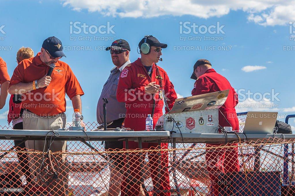 Commentator, staff and snowbirds coordinators stock photo