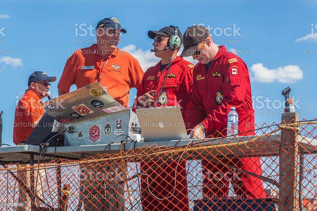Commentators and snowbirds coordinators stock photo