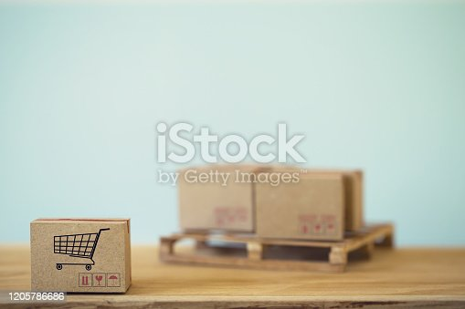 E- commerce and online shopping concept : Cardboard boxes for packing of goods with icon. Transportation, logistics, global shipping, international freight, overseas trade, regional, go to worldwide