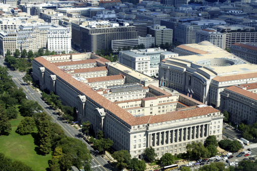 Aerial view of the Herbert Hoover Building which houses the Department of Commerce in Washington DC. This is the second largest Federal Office Building after the Pentagon.  The building to the right with the big circular space is the Ronald Reagan Office Building.  Second Italian Renaissance Revival Rural Villa Style, which drew its orginal architectural insperation from rural villas in Italy, as hard as it is to imagine looking at this building - See lightbox for more