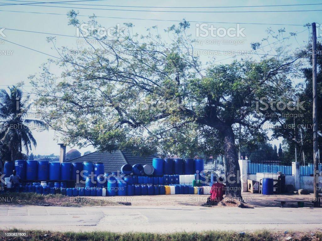 Dar es Salaam, Tanzania - August 03, 2018: Vendor is selling...