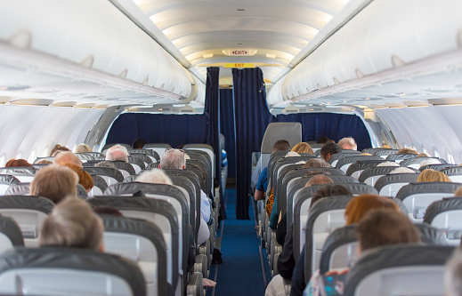 Commercial Aircraft Cabin With Passengers Stock Photo - Download Image Now
