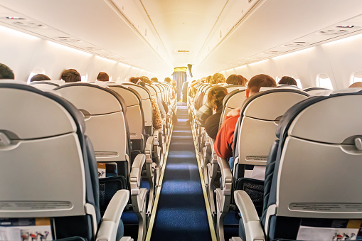 Commercial Aircraft Cabin With Rows Of Seats Down The Aisle Stock Photo - Download Image Now