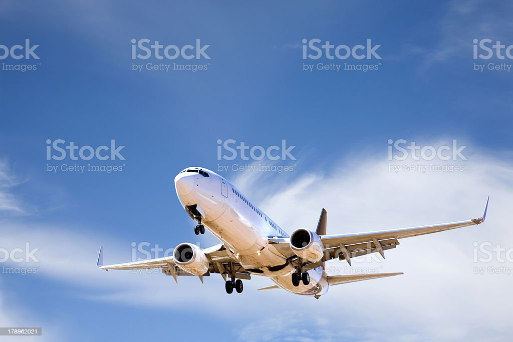 Commercial Aircraft in Summer Sky royalty-free stock photo