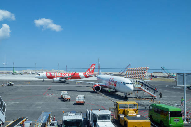 Commercial Aircrafts on the Run at Ngurah Rai International Airport, Bali. stock photo