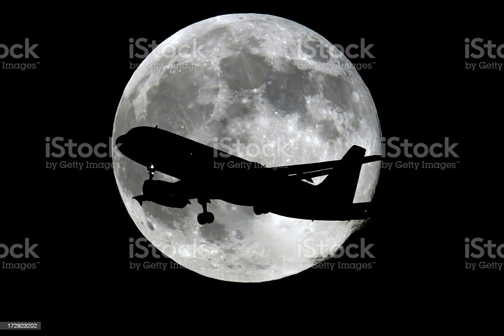 Commercial Airliner at night stock photo