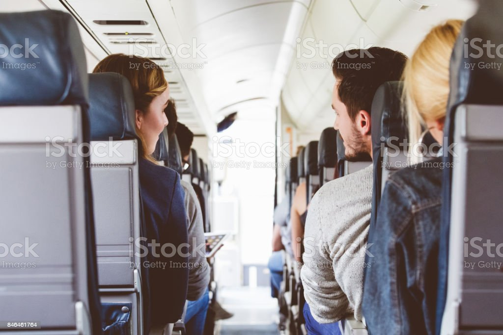 Commercial airliner cabin with people travelling stock photo